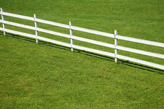 Wooden fence on a green lawn Royalty Free Stock Images