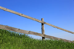 Wooden fence on green meadow Royalty Free Stock Photos