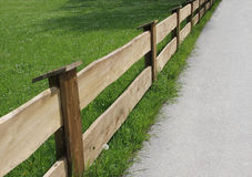 Wooden fence and green meadow, diagonally Stock Photography