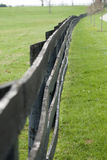 Wooden Fence in Green Pasture Royalty Free Stock Images