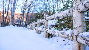 Wooden fence with heavy snow. Wooden fence in the forest with heavy snow stock image