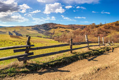 Wooden fence on the hillside. Wooden fence on hillside in the rural area Stock Images