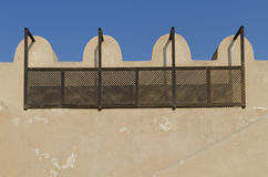 Arabic fort details. Wooden fence on the inside wall of arabic fort Royalty Free Stock Photo