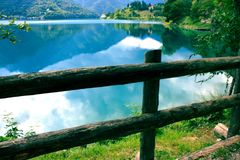 Wooden fence on lake coast