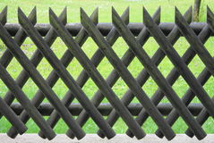 Wooden fence with lattice Stock Images
