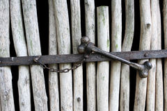 Wooden fence with a lock in the form of metal dice as the background Stock Photography