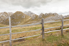 Wooden fence long a path in Val di Funes Royalty Free Stock Image