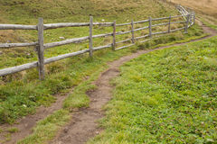 Wooden fence long a path in Val di Funes Royalty Free Stock Photography