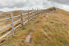 Wooden fence long a path in Val di Funes Stock Images
