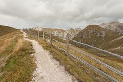Wooden fence long a path in Val di Funes Stock Photography