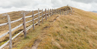 Wooden fence long a path in Val di Funes Stock Image