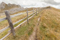 Wooden fence long a path in Val di Funes Royalty Free Stock Photos