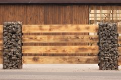 Modern Fence Made From Metal Siding And Profile Sheet Like As Natural Wood Board royalty free stock photos