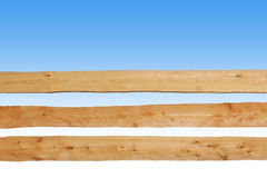 Wooden fence made of horizontal planks, against blue sky. With copy space, background illustration royalty free stock photo