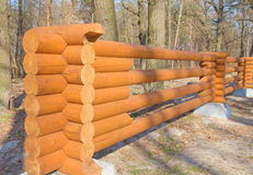 Wooden fence made of logs Royalty Free Stock Photos