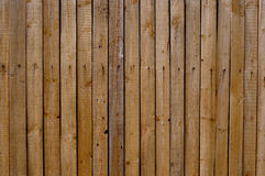 Wooden fence made of old boards. Vertical wooden fence made of old boards Stock Photo