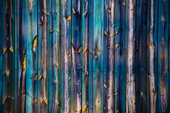 Wooden fence of many colors Royalty Free Stock Image