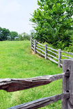 Wooden Fence and Meadow Stock Photography