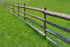 Wooden fence on meadow Royalty Free Stock Photos