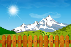Wooden fence and mountain landscape in background Royalty Free Stock Image