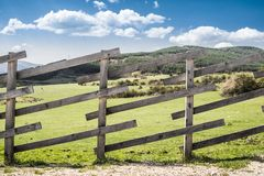 Wooden fence on a mountain ranch. Sunlight stock images