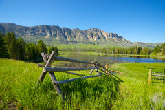 Wooden Fence and Mountain Scene Stock Photos