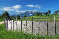 Wooden fence and mountain view. Wooden fence and view to Alps in Slovenia Royalty Free Stock Photo