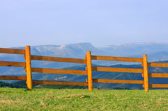Wooden fence with mountains Royalty Free Stock Photography