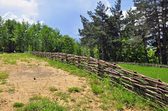 Wooden fence near the forest Stock Images