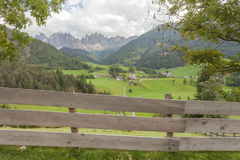 Wooden fence next to  an Italian mountain pasture in St. Magdalena in Val di Funes Stock Photography