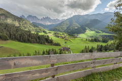Wooden fence next to  an Italian mountain pasture in St. Magdalena in Val di Funes Stock Photo