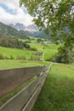 Wooden fence next to  an Italian mountain pasture in St. Magdalena in Val di Funes Stock Image