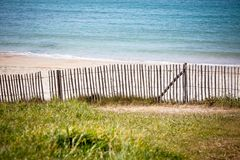 Wooden fence at Northern beach in France. Horizontal shot stock images