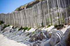 Wooden fence at Northern beach in France. Horizontal shot royalty free stock image