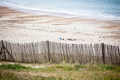 Wooden fence at Northern beach in France. Wooden fence at Northern sea beach in France. Horizontal shot stock photo