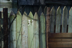 Wooden fence, with the number 31 of the plot. Summer cottage. An old fence Stock Photography