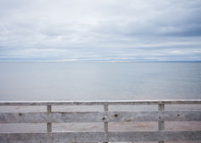 Wooden Fence and Ocean Background Stock Photography