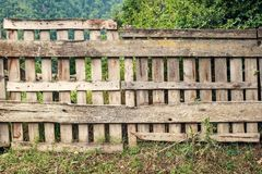 Wooden fence. Old rough wooden fence in the village stock image