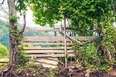 Wooden fence. Old rough wooden fence in the village royalty free stock photography