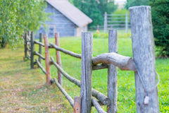 A wooden fence and old rural house Stock Image