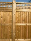 Wooden fence panelling which is sunlit. Wooden fence panelling with fancy top, golden in color and sunlit Stock Photos