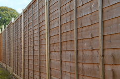 Wooden fence panels. Row of newly erected wooden fence panels stock photos