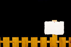 Wooden fence with a paper plate Royalty Free Stock Photo