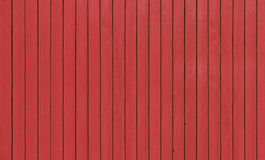 Wooden fence with parallel planks with red paint. Stock Photo