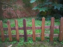 Wooden fence. In the park stock images