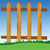 Wooden fence in park with blue sky in background Royalty Free Stock Photos