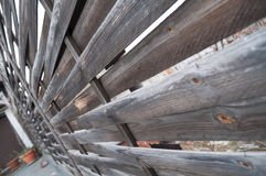 Wooden fence and patchworks, interesting viewpoint Royalty Free Stock Images