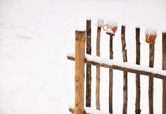 Wooden fence and pitchers. Winter Royalty Free Stock Image