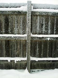 Wooden fence post and snow Stock Photography