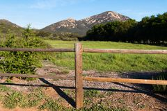Wooden Fence In Poway, California with Iron Mountain. In the background royalty free stock images